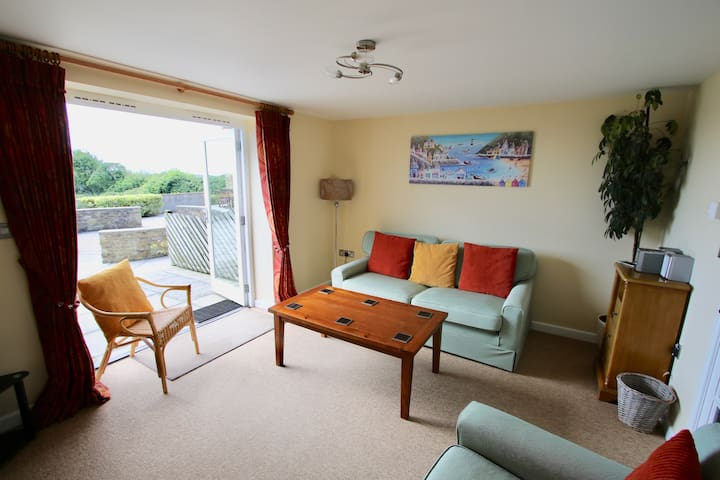 Lounge with double bed settee.  Patio doors onto the patio and communal courtyard