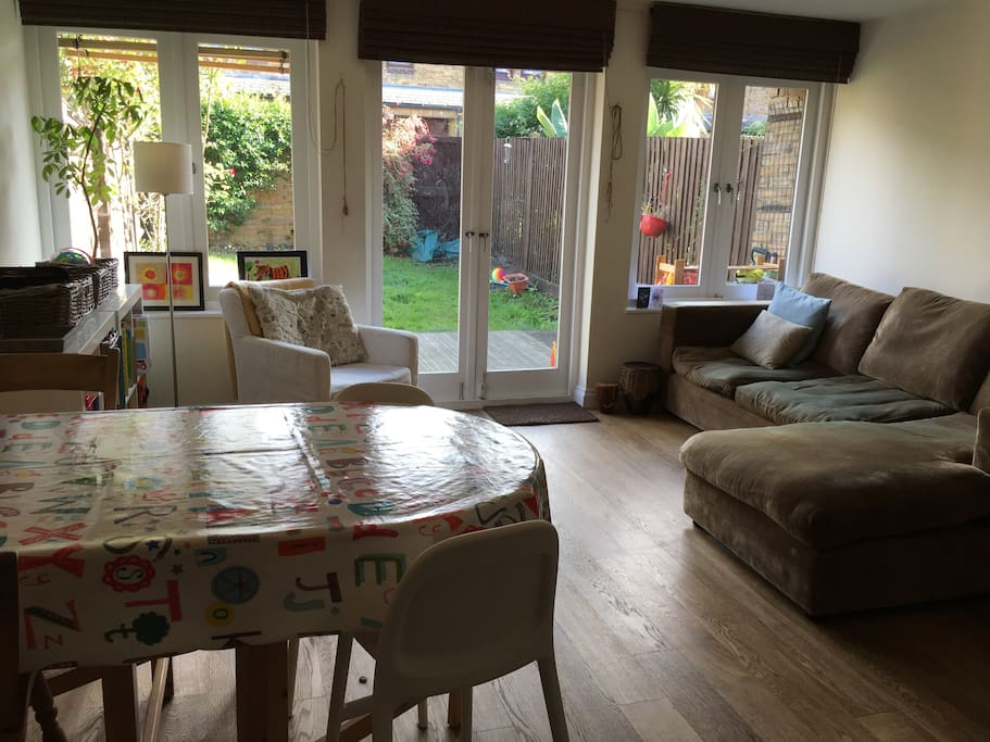 Living room with french doors leading onto decking