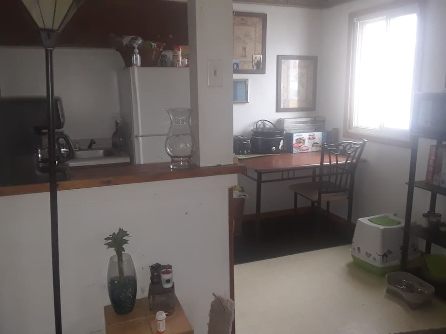 kitchen with coffeepot, crockpot, new dishes and will provide some food/beverages
