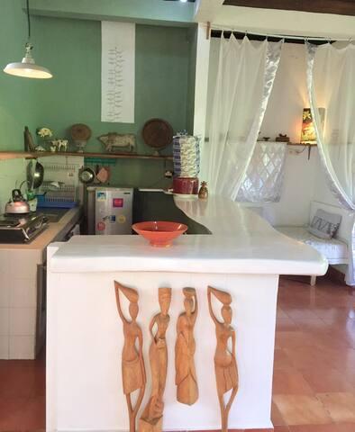 KITCHEN AREA: gas cooker, fridge, water dispenser, shelves