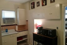 Kitchen with Coffee Pot, Toaster and Microwave