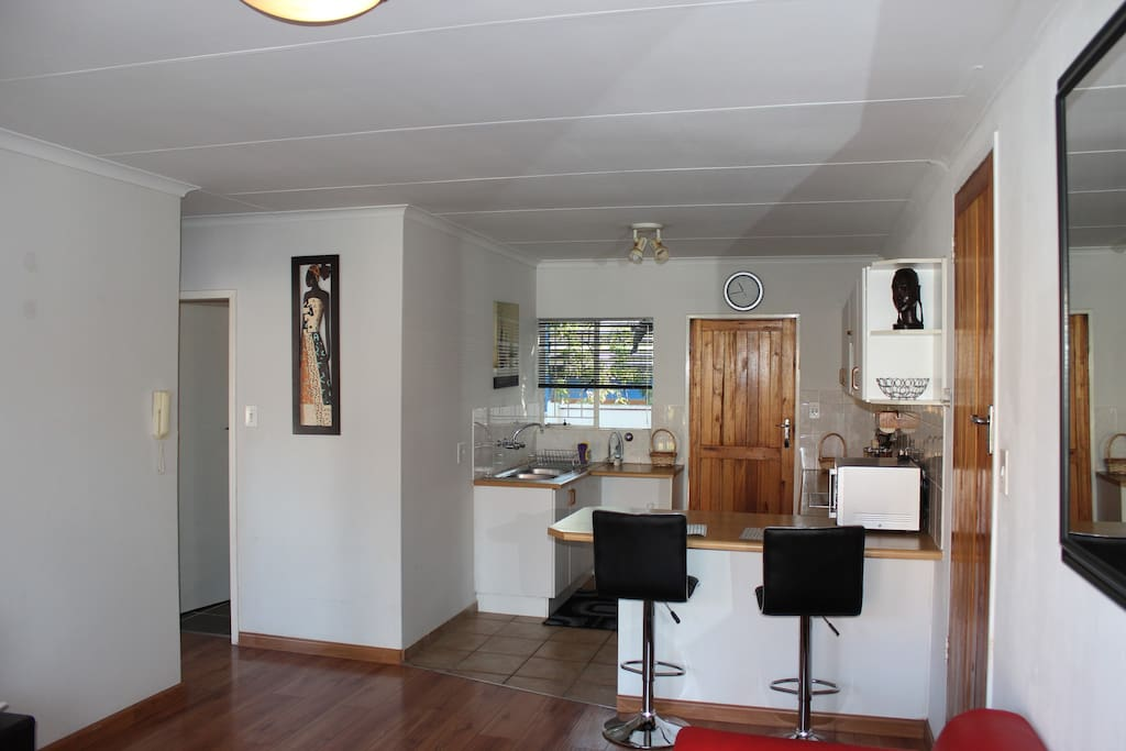 Kitchen area with two bar stool