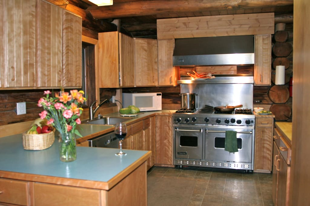 The kitchen of the Main Lodge has a six-burner and two-oven stove, propane grill on deck, large refrigerator, dishwasher, microwave, toaster, coffee pot, and plenty of room to prepare a delicious meal.