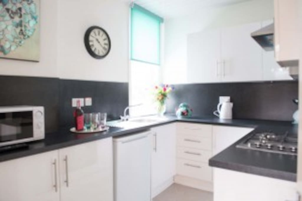 The modern kitchen comes with pots, pans, utensils, complimentary tea and coffee.