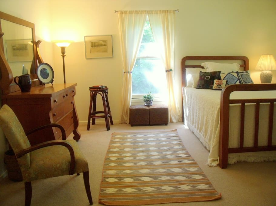 Spacious bedroom has double bed with great mattress, cable TV, armchairs and big walk-in closet and lots of light.
