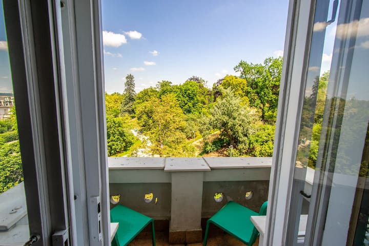 There is a balcony in the apartment with beautiful park view.
