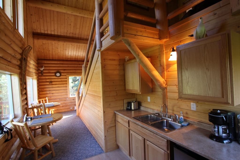 The cabin has a common area with a refrigerator, toaster oven, microwave, and coffee pot.