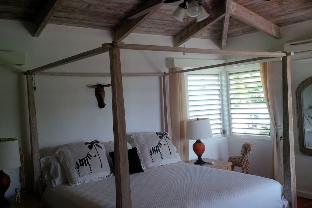 One of three bedrooms (each bedroom is decorated individually, with Caribbean style)