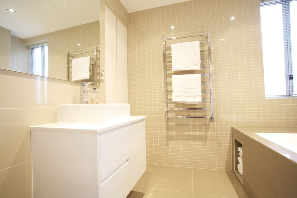 Main bathroom with WC, bath / shower and internal laundry