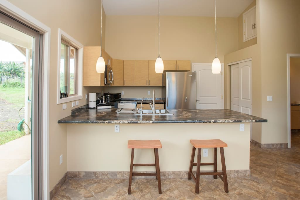 The kitchen counter doubles as a dining table or a perfect place to enjoy a cocktail and critique the cook.