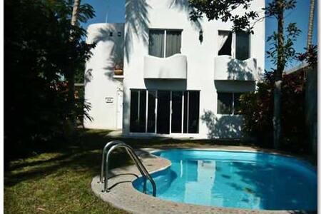 White Riverside house
