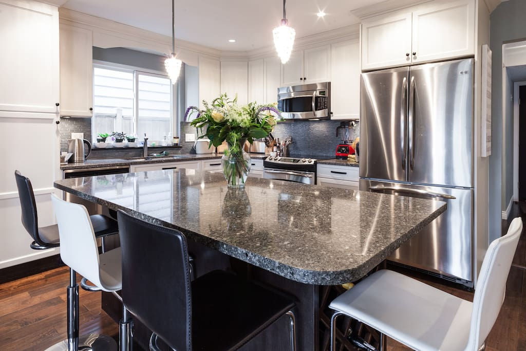 Stone countertops and GE appliances.