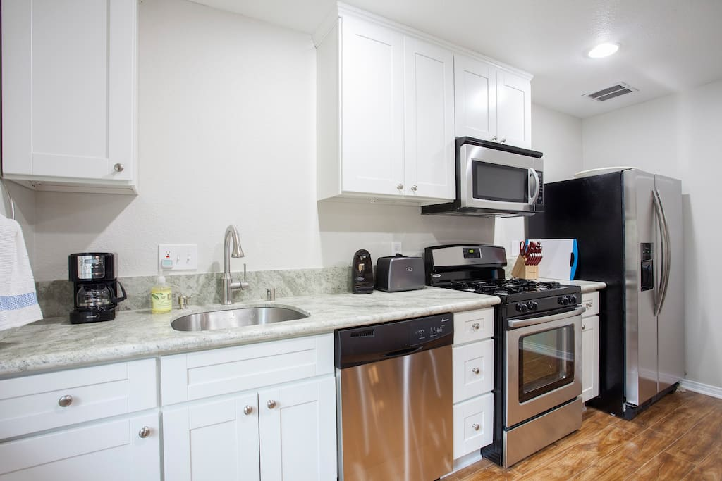 Complete kitchen with dishwasher, stove,refrigerator,freezer, toaster, microwave, Mr. Coffee coffee maker which is a drip coffee maker, electric tea kettle, can opener, complete set of pots and pans.