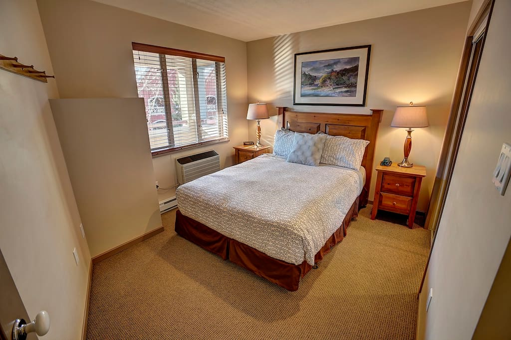 Master Bedroom with view. Queen size bed with warm down comforter and lots of closet space.