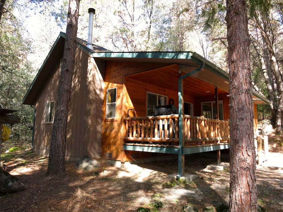 This cozy 2 bedroom cabin with a front deck nestled in the forest