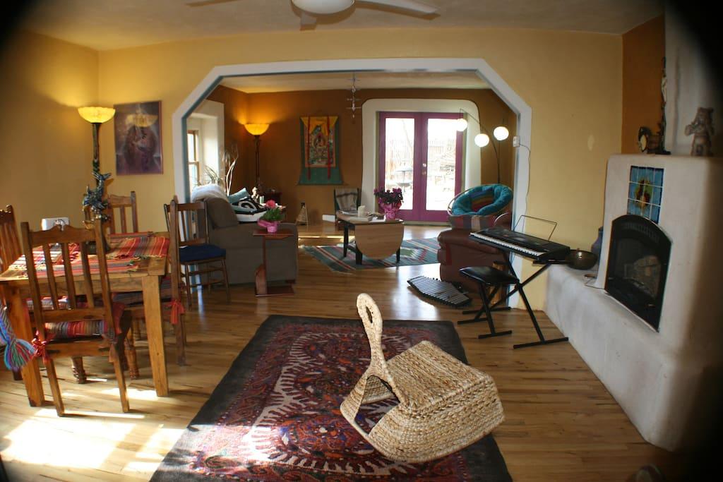 Dining area and gas log fireplace, beautiful oak floors