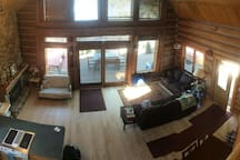Lower log cabin w 3 bedrooms 2 baths, with additional bedroom and bath in a private study/game room above the garage.