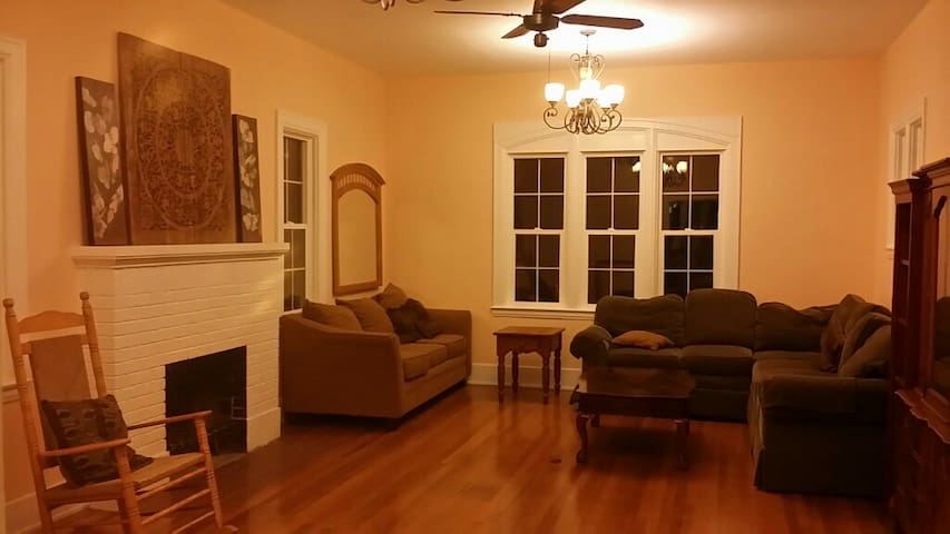 Relax in this inviting living room with old-world charm and original hardwood floors.