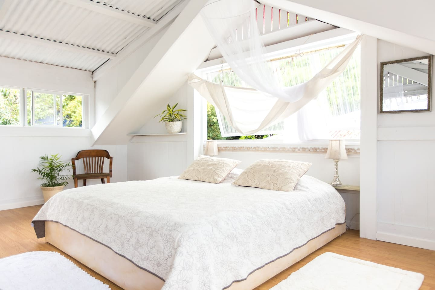 The Attic Bedroom of 'The Sugar Shack' offers a peaceful retreat and a California King Bed for a good night's rest.