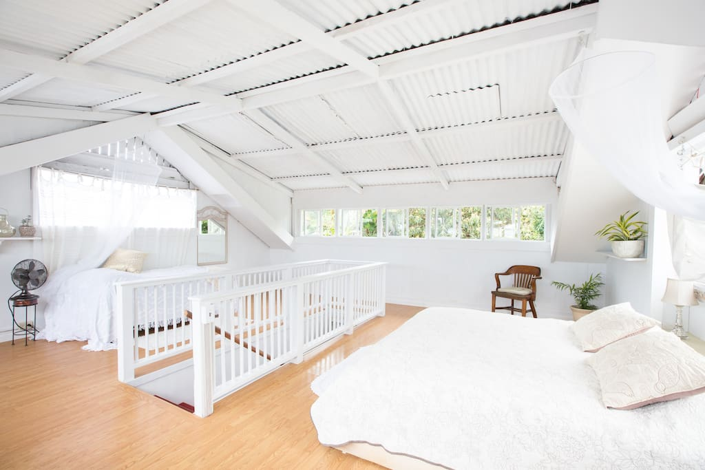 The 'Attic Bedroom' is light and airy and has views of the garden and Hilo Bay