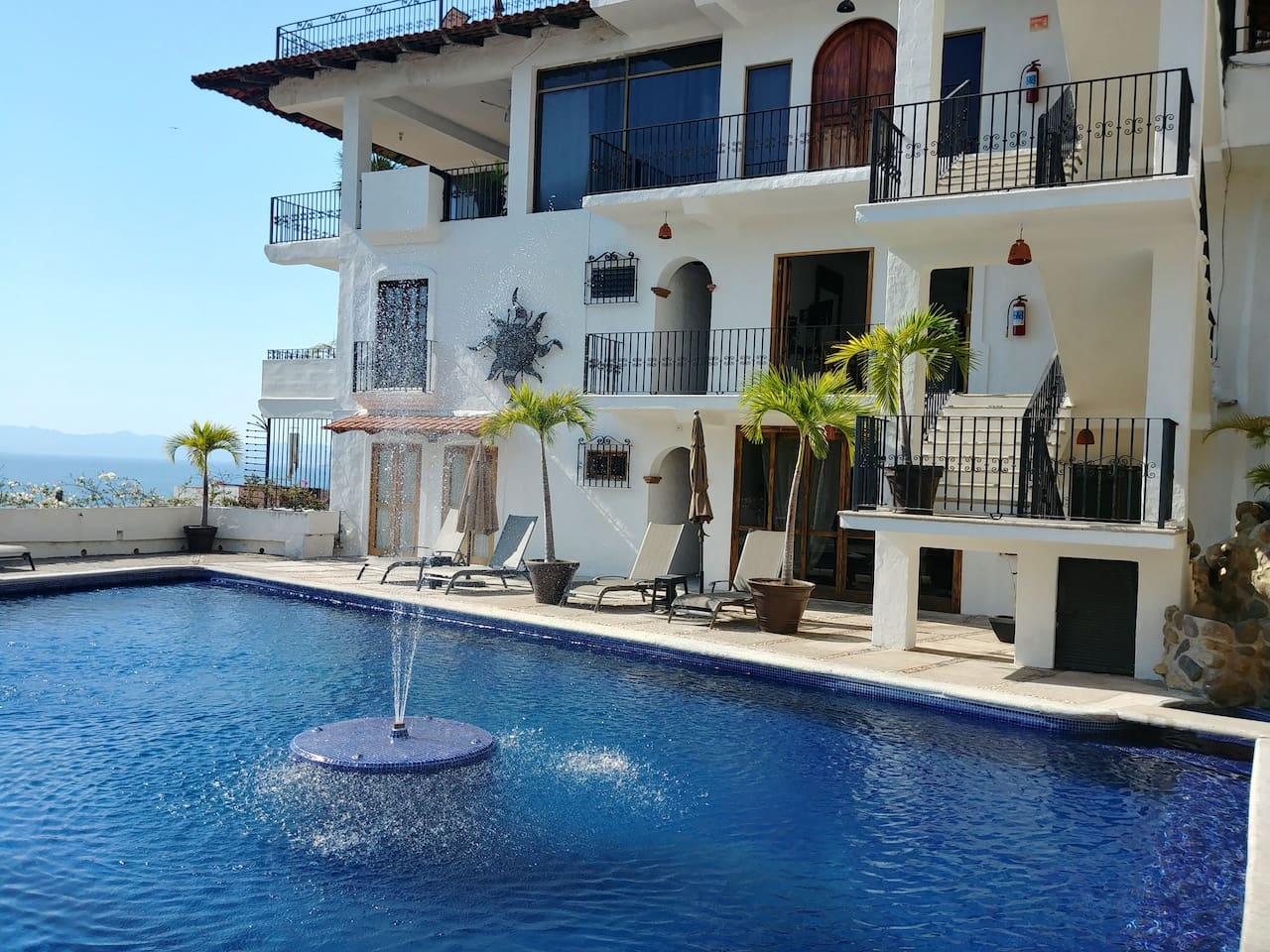 Large saltwater pool right outside condo door