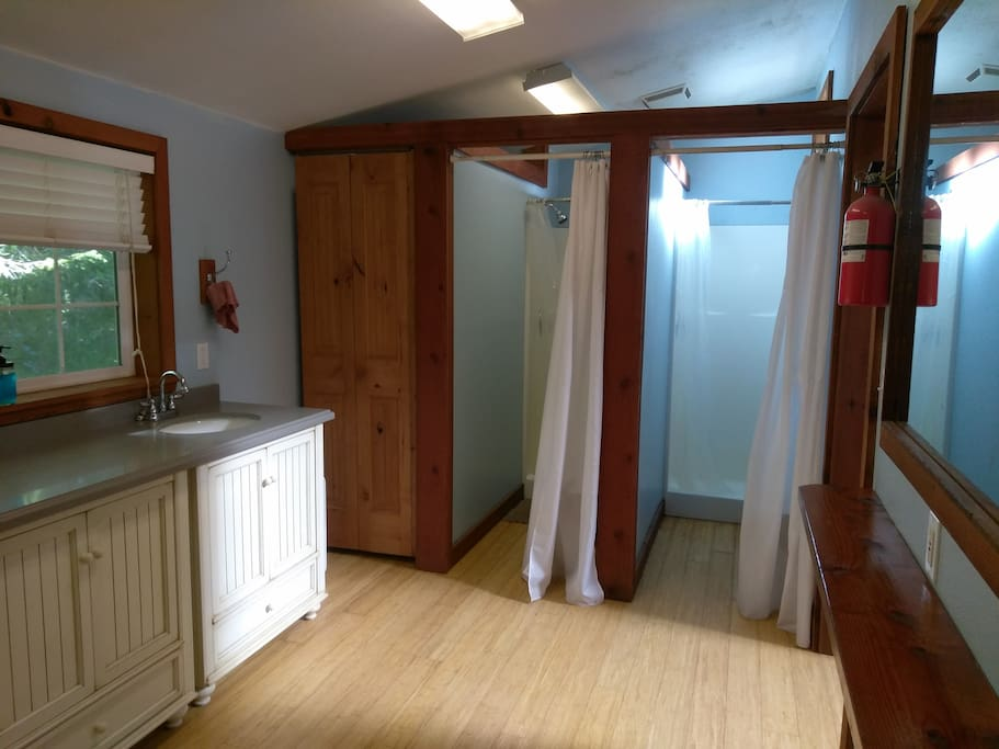Attached to the yurt is a communal bathroom space with 3 showers and 3 bathroom stalls.