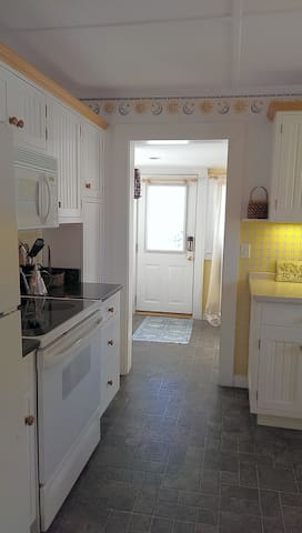 Mudroom off the back door leads to the kitchen.