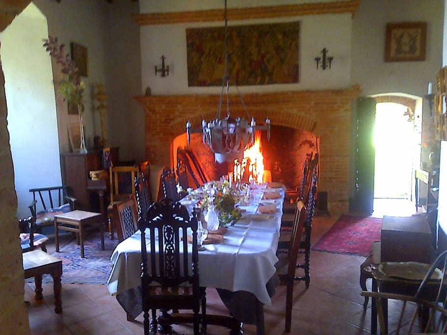 Dining room. Another grand fireplace.