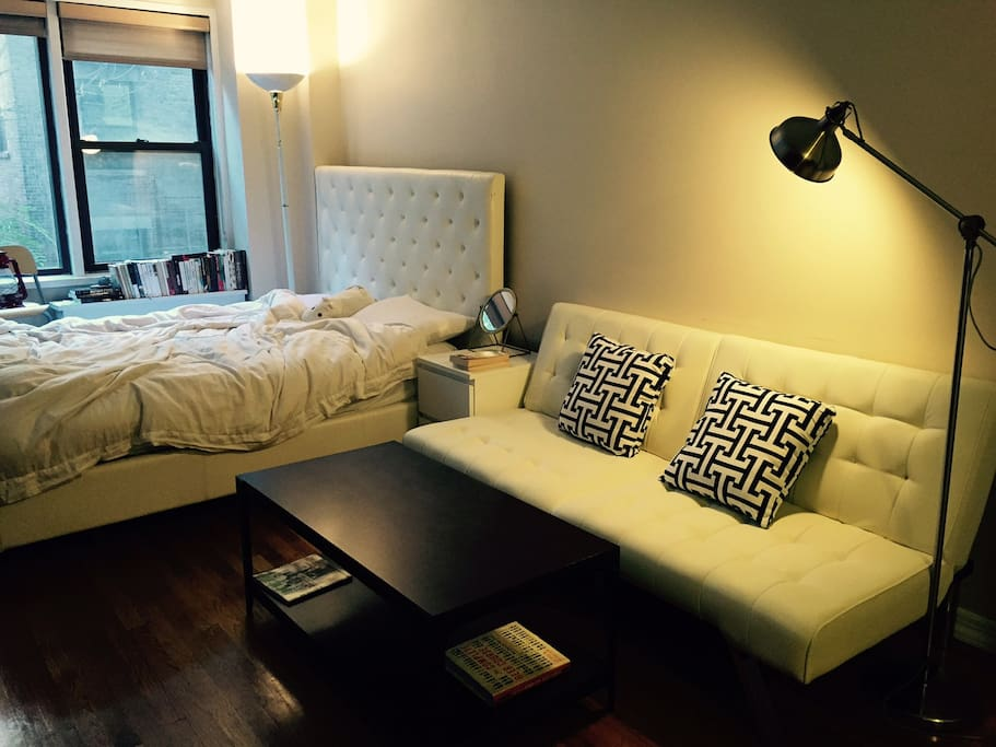 a bed and a couch with the light on :D