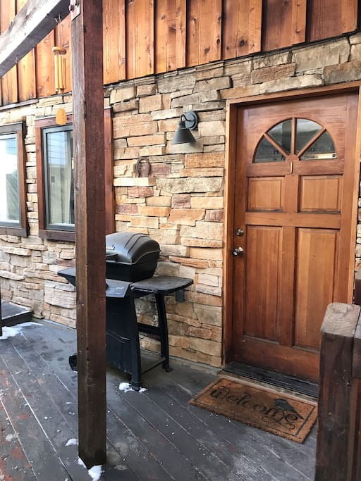 Front door of condo, grill for use