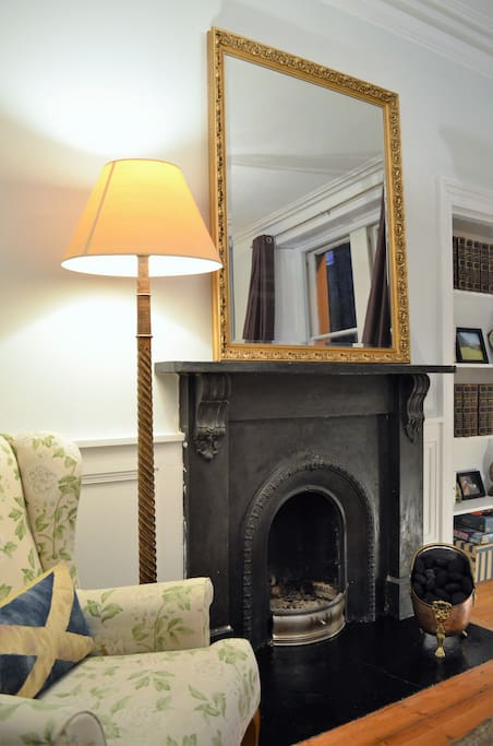 Nice reading chair next to fireplace in Living Room