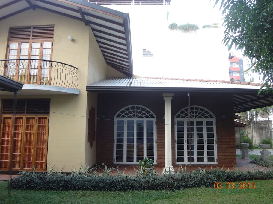 Side view of the house with the balcony of one room