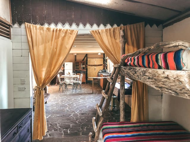 Spacious bunk room with bottom double bed and dresser