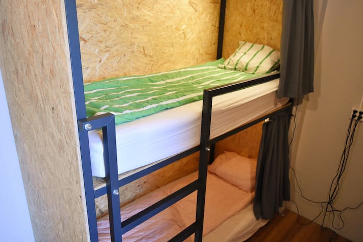 Single Enclosed Bunk Bed in 8-Bed Dorm Room