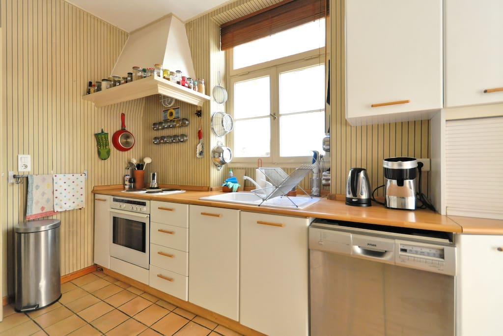 Fully fitted kitchen with sun-light from the courtyard