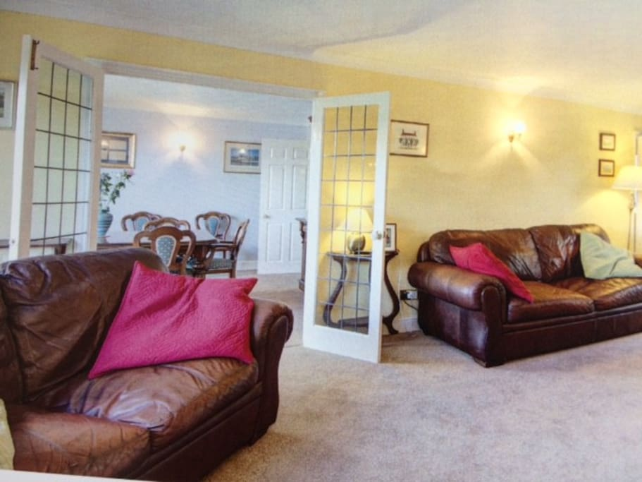Large Living room opens onto large dining room (8 main chairs plus others) table can be extended further. Gas fire. Central  heating throughout (not garden 5th bedroom which has an electric fire)