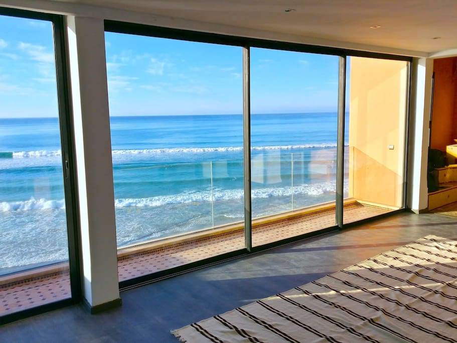 The living room enjoys floor to ceiling views straight out to the atlantic - perfect for watching the sets roll in.