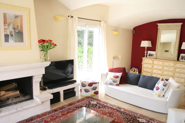 Sitting room, 2 large sofas, 2 armchairs, coffee table, antique rug & armoire, firelace & TV