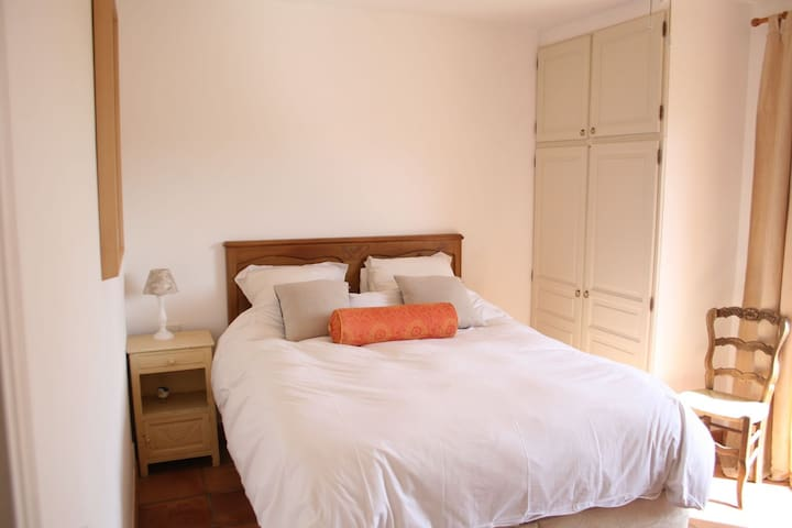 Air-conditioned Double Bedroom 2 with Kingsize bed opening onto upper terrace