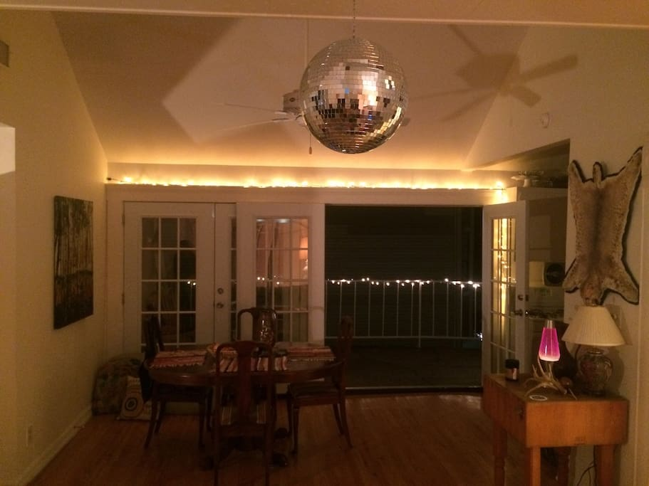 Dining area opens up to the terrace... And the Disco ball spins.