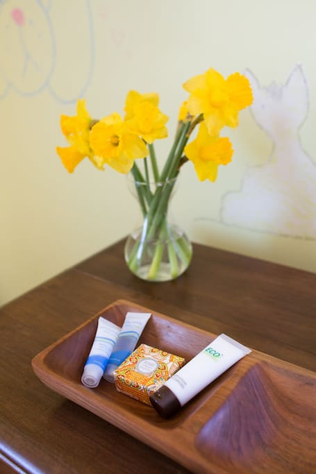 On your dresser, you'll find fresh flowers and complimentary eco-friendly soap, shampoo, conditioner, and lotion.