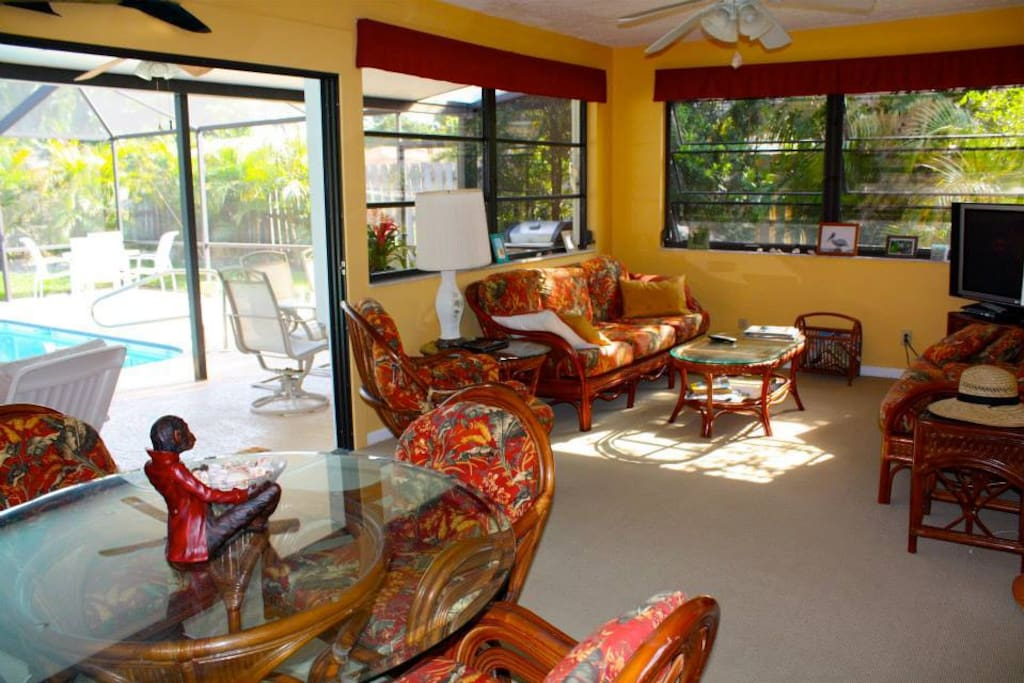 Casual family and dining area with tv; leads out to pool and screened in lanai
