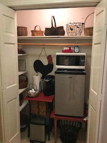 Kitchenette area featuring mini-refrigerator, small microwave, Kuerig Coffee Maker.