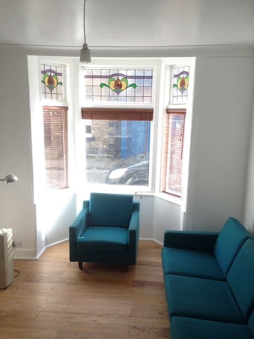 Bright lounge with views of cobbled high street