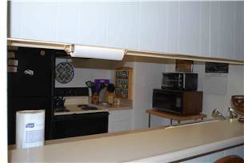 Enjoy the kitchen fully stocked with cookware, a blender, mixer, crock pot, waffle iron, and spice rack.
