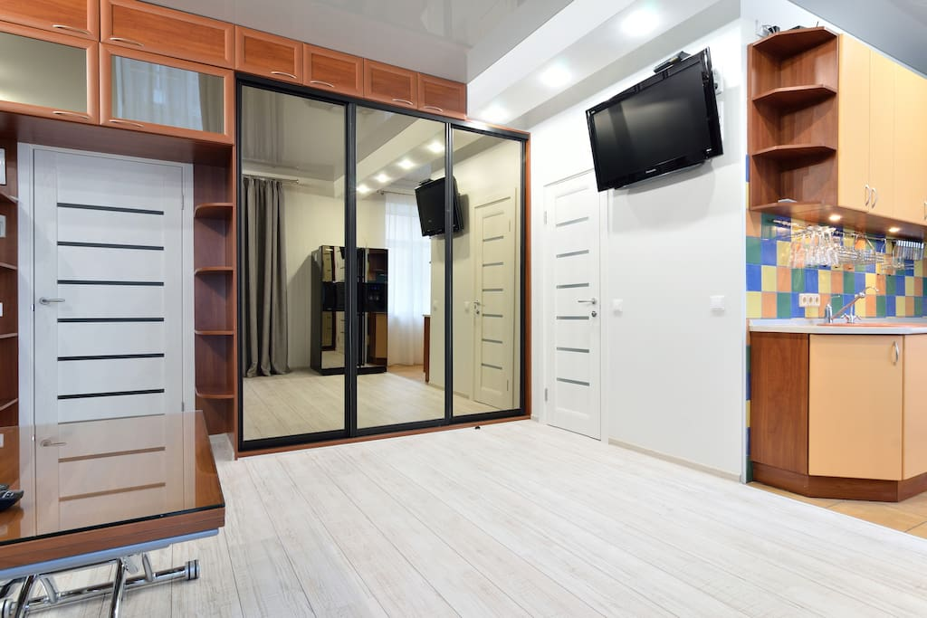 Spacious wardrobe in the living room, flat screen TV.