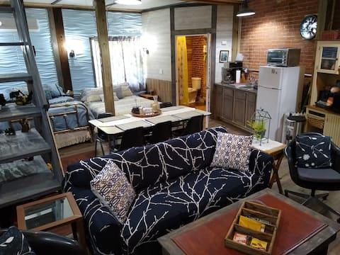 1st Flr Studio Apt Sleeps 12 in Historic Feed Mill
