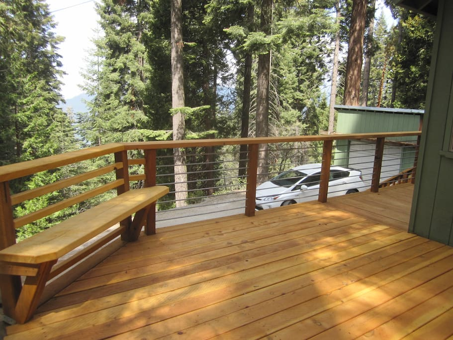 Enjoy valley and mountain views from this deck that opens out to  the dogwood - studded  yard.