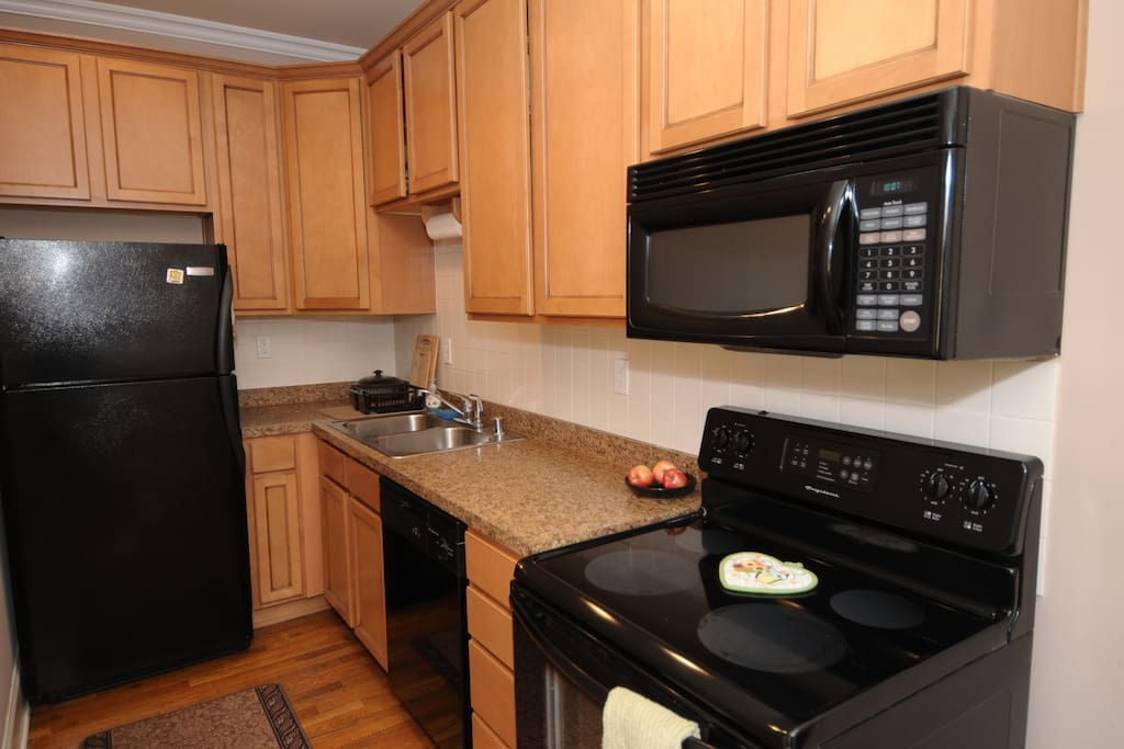 Modern Kitchen, fully stocked with plates, dishes, pots, pans, and even a Panini maker.
