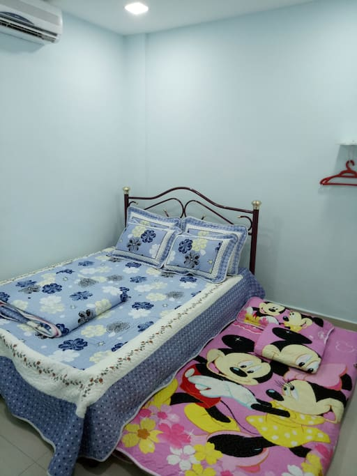 2nd bedroom with 1 queen bed, 1 single bed, air-conditioning & hanging rack...